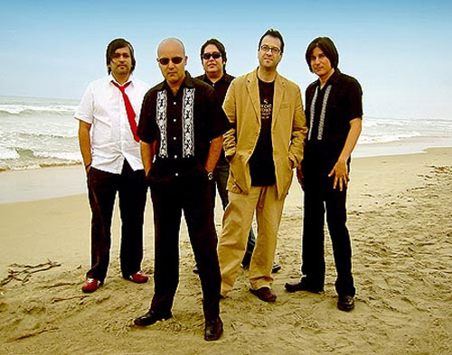 Members of the Nortec Collective stand at the beach