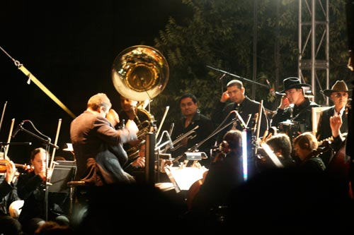 The conductor leads members of La Orquesta de Baja California in unison with the Nortec Collective's electronic beats.