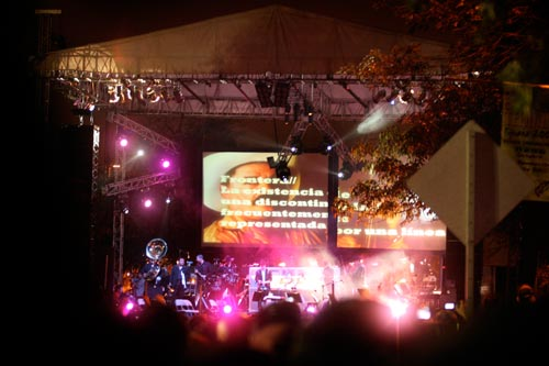 Video screens accompany the live performance.